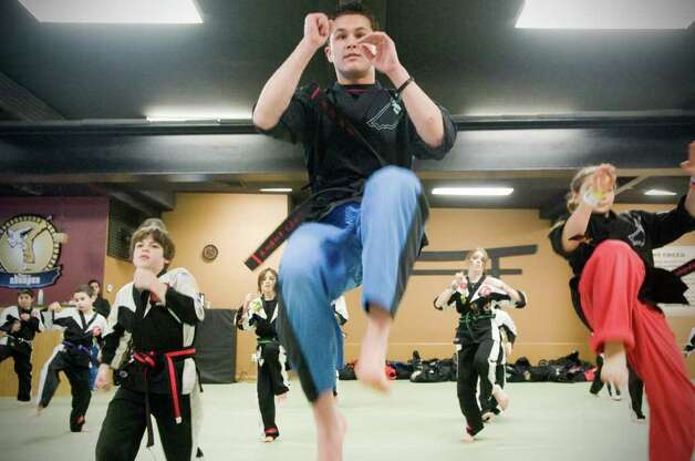 Ryan Matherne, 23, leads a class at The Dojo on Long Ridge Road in Stamford, Conn., Jan. 24, 2011. Matherne will climb the stairs of the Empire State Building in bare feet to demonstrate discipline and endurance and to raise money for charity. Photo: Keelin Daly / Stamford Advocate
