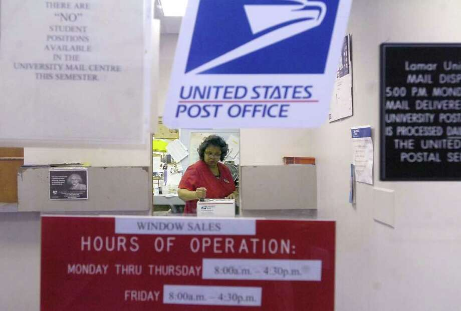Postal Clerk Cynthia Perkins stamps another piece of priority mail that has been dropped off at the post office located on the Lamar University campus next to the campus Police station.  The site handles anywhere from 200 to 300 people a day and approximately 1.2 million pieces of mail are processed through the facility a year.  The The U.S. Postal Servicde must close a gap of $8.5 billion and might close 2,000 post offices to help cut costs. Dave Ryan/The Enterprise Photo: Dave Ryan / Beaumont