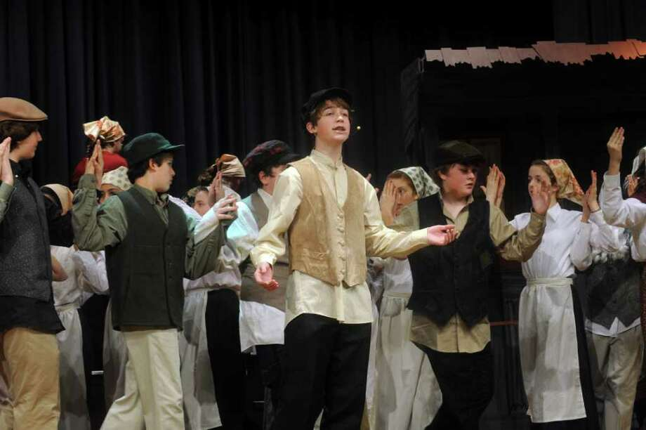 "William Jones, playing Tevye, center,in  a rehearsal of the Eastern Middle School eight-grade show chorus' production of ""Fiddler on the Roof,"" on Monday, Jan. 24, 2011. The Eastern Middle School eighth-grade show chorus will perform the musical ""Fiddler on the Roof"" from Jan. 27-29 in the school's Lee Book Auditorium, 51 Hendrie Ave. Show times are 4 p.m. Jan. 27, 7:30 p.m. Jan. 28 and 7:30 p.m. Jan. 29. Tickets for the Jan. 27 show are $5, and the following two shows are $10. Tickets are on sale in the main lobby of the school every day before school from 7:15 to 7:45 a.m. and after school from 2:45 4 p.m. Ticket reservations can also be made over the phone by calling the school office at 203-637-1744. Photo: Helen Neafsey / Greenwich Time"