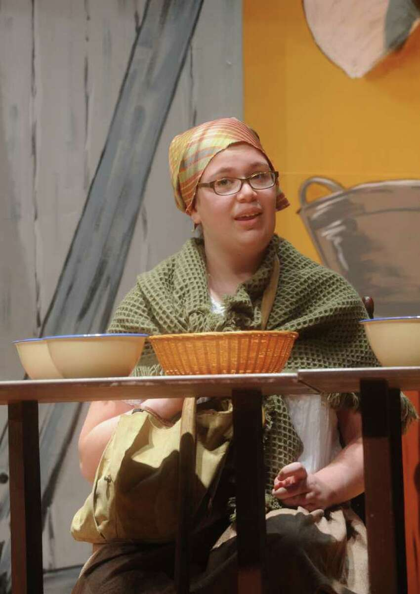 Megan Muratore as Yente the matchmakerin a rehearsal of the Eastern Middle School eight-grade show chorus' production of
