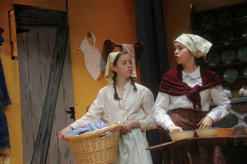 Elizabeth Ast playing Tzietel, left, and Grace Barber as Tevye's wife Golde, in a rehearsal of the Eastern Middle School eight-grade show chorus' production of