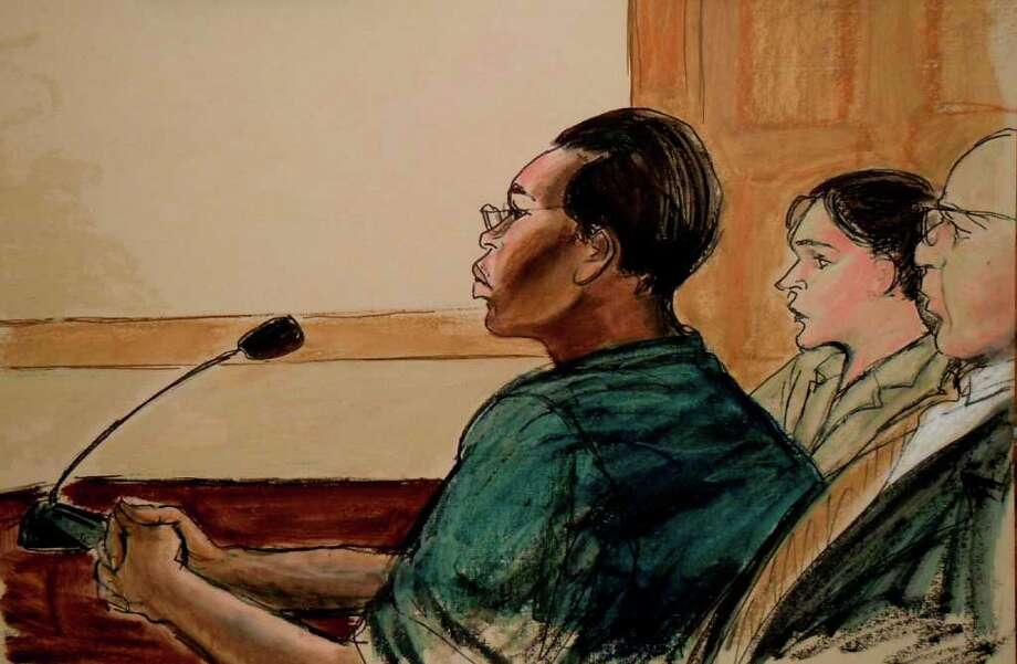In this courtroom sketch, Ann Pettway, left, the woman accused of kidnapping infant Carlina White from a New York hospital more than two decades ago, is shown seated in court with her attorneys Sabrina Schroff, center, and Robert Baum, right, on Monday, Jan. 24, 2011, in New York.  Pettway surrendered Sunday, days after a widely publicized reunion between the child she raised, now an adult, and the biological mother. (AP Photo/Elizabeth Williams) Photo: AP