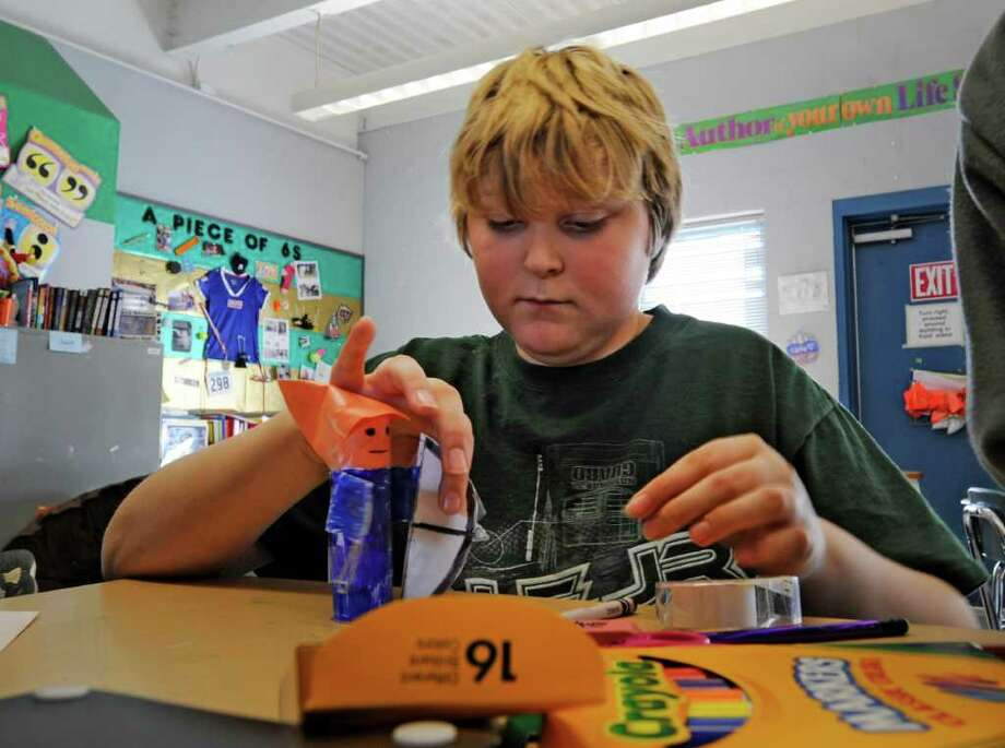 James Taylor uses his creativity in the classroom at the Latham Ridge Elementary School in Latham while on class recess on a day when it was too cold to go outside, January 24, 2011. (Skip Dickstein / Times Union) Photo: SKIP DICKSTEIN