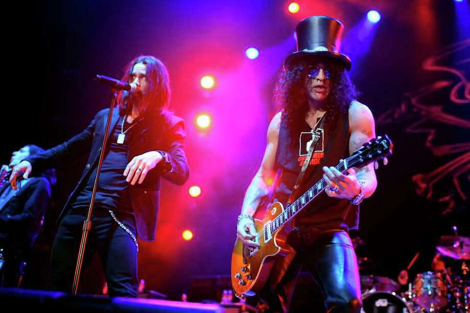 Slash (right) and Myles Kennedy perform Monday, Jan. 24, 2011 at the AT&T Center. Photo: EDWARD A. ORNELAS, SAN ANTONIO EXPRESS-NEWS / eaornelas@express-news.net