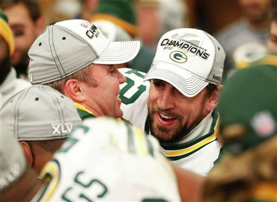 Packers quarterback Aaron Rodgers (right) and head coach Mike McCarthy celebrate after Sunday's NFC Championship victory over the Bears. Photo: David J. Philip/Associated Press