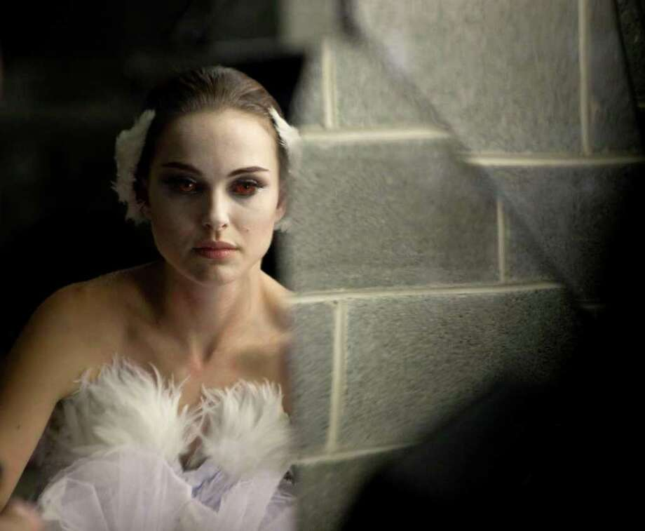 """In this film publicity image released by Fox Searchlight, Natalie Portman is shown in a scene from """"Black Swan."""" The film was nominated for an Academy Award for best film, Tuesday, Jan. 25, 2011. The Oscars will be presented Feb. 27 at the Kodak Theatre in Hollywood.  (AP Photo/Fox Searchlight, Niko Tavernise) Photo: Niko Tavernise, AP / AP2011"""