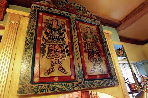 A folk art painting found in an antiques store hangs above the vent hood.  PHOTO BY TOM REEL/treel@express-news.net Photo: TOM REEL, SAN ANTONIO EXPRESS-NEWS / © 2010 San Antonio Express-News