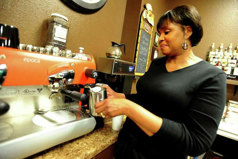 Alice Rawls makes an espresso in the Hebrews Coffee Shop at Harvest Church in Jasper, Thursday. Tammy McKinley/The Enterprise Photo: TAMMY MCKINLEY / Beaumont