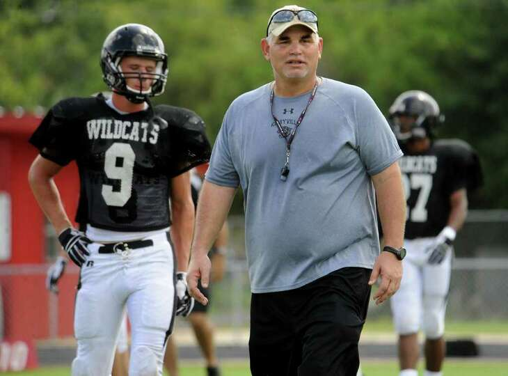 Kirbyville's Coach Jack Alvarez coaches during a scrimmage against Silsbee at Kirbyville High School