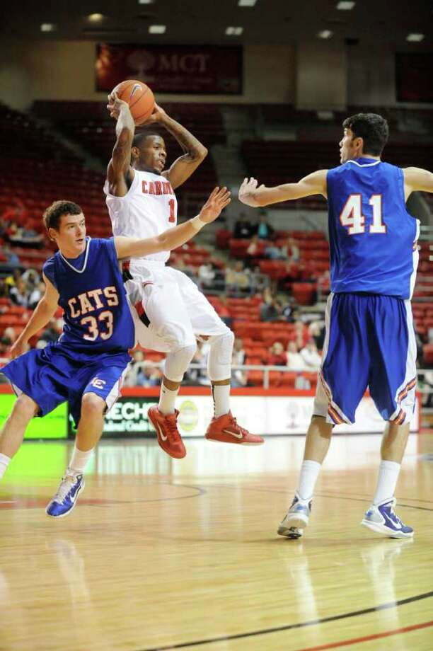 Lamar guard Anthony Miles passes the ball against Louisiana College defenders, Danny Sumner, left, and Korey Salmon, right, at the Montagne Center.  Tuesday, January 4, 2010 Valentino Mauricio/The Enterprise Photo: Valentino Mauricio / Beaumont