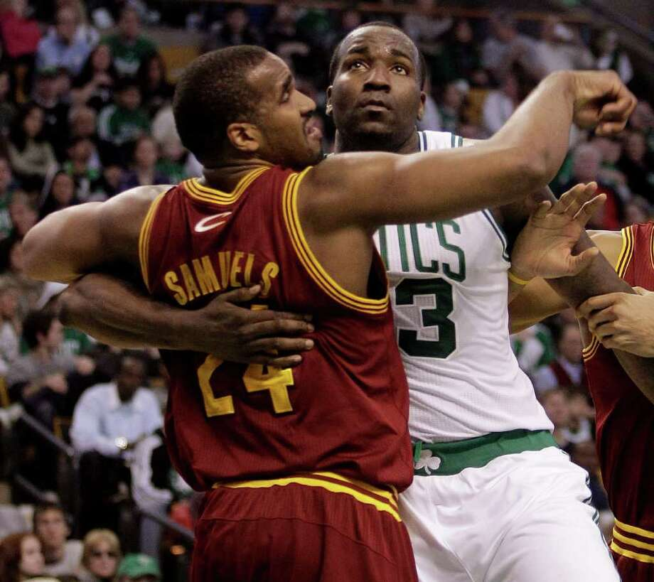 Boston Celtics center Kendrick Perkins (43) tries to fight his way through Cleveland Cavaliers forward Samardo Samuels (24) while waiting for a rebound during the second quarter of an NBA basketball game at the Garden in Boston, Tuesday, Jan. 25, 2011. (AP Photo/Stephan Savoia) Photo: Stephan Savoia, STF / AP