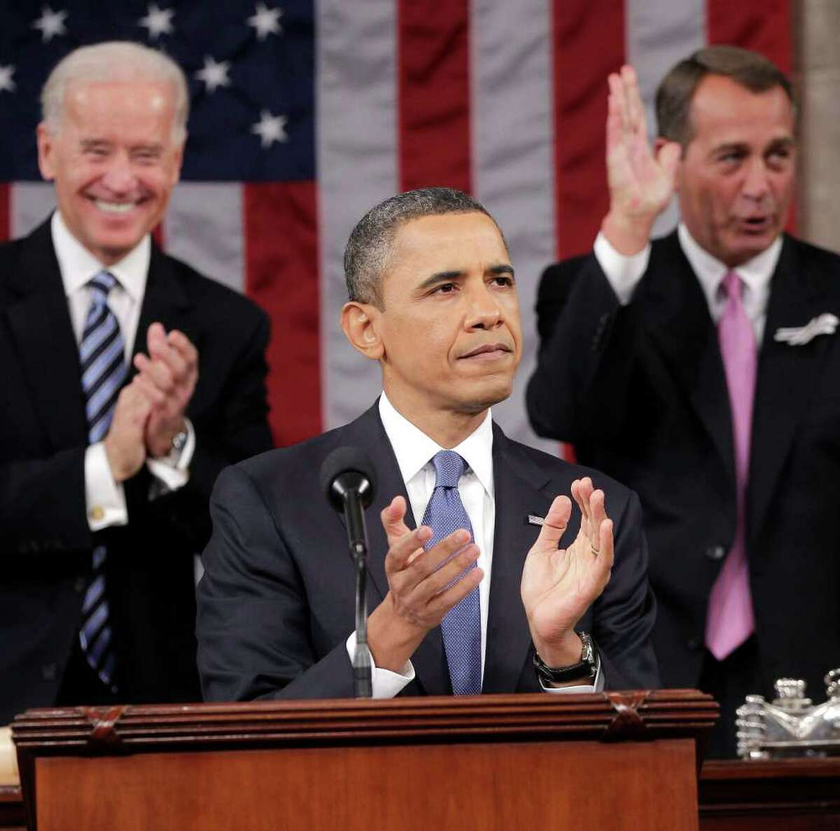 President Barack Obama is applauded by Vice President Joe Biden and House Speaker John Boehner of Ohio, prior to delivering his State of the Union address on Capitol Hill in Washington, Tuesday, Jan. 25, 2011.
