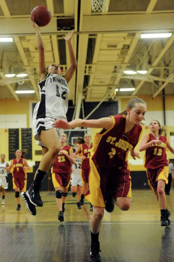 Trumbull's Taisha Lima takes a shot against St. Joseph during Tuesday's game at Trumbull High School on January 25, 2011. Photo: Lindsay Niegelberg / Connecticut Post