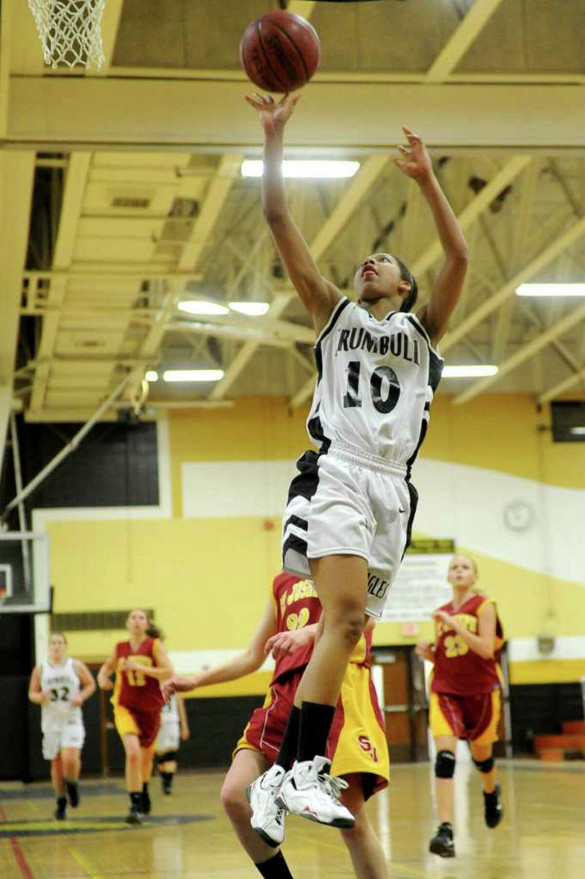 Trumbull's Mookie Kennedy takes a shot against St. Joseph during Tuesday's game at Trumbull High School on January 25, 2011.