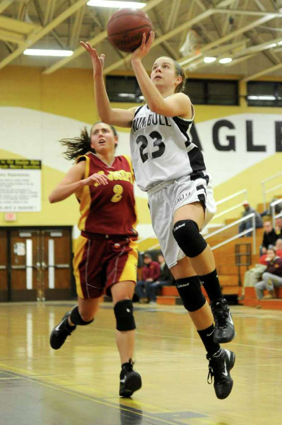 Trumbull's Victoria Pfohl takes a shot against St. Joseph during Tuesday's game at Trumbull High School on January 25, 2011.
