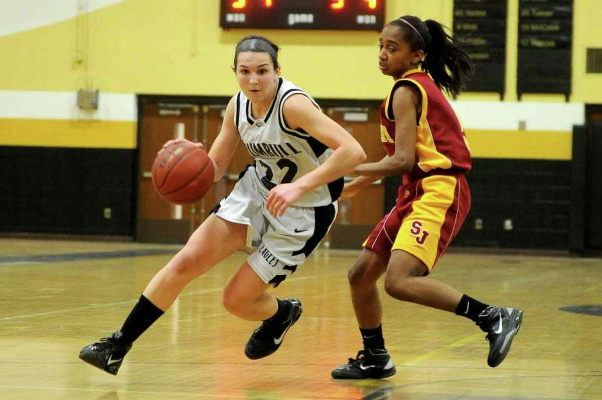 Trumbull's Kelly Coughlin dribbles past St. Joseph's Teneya McLaughlin during Tuesday's game at Trumbull High School on January 25, 2011.