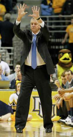Connecticut Coach Jim Calhoun instructs his team against Marquette in the first half of an NCAA college basketball game Tuesday, Jan. 25, 2011, in Milwaukee. (AP Photo/Jeffrey Phelps) Photo: AP