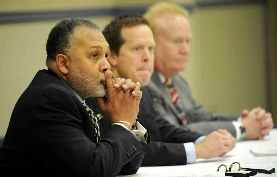 City Attorney Tyrone Cooper, City Manager Kyle Hayes, and Police Chief Frank Coffin listen to the opinions of a variety of speakers during a public hearing about a citizen's police-community advisory committee at the Civic Center in Beaumont, Tuesday Tammy McKinley/The Enterprise Photo: TAMMY MCKINLEY / Beaumont