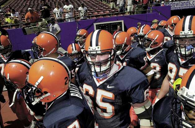 In this August 2001 file photo, Greenwich native Joe Burton of Syracuse (65) enters Giants Stadium with his teammates prior to a game against Georgia Tech. Photo: File Photo / Greenwich Time File Photo
