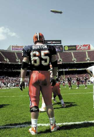 In this August 2001 file photo, Greenwich native and Syracuse University football player Joe Burton on the field at Giants Stadium before a game against Georgia Tech. Photo: File Photo / Greenwich Time File Photo