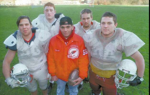 In this November 1996 file photo, the Greenwich High School football team's offensive line is shown: from left, Nick Lodato, Joe Burton, Jeff Natale, Chris Moxhay and Will Ostruzka. Photo: File Photo / Greenwich Time File Photo