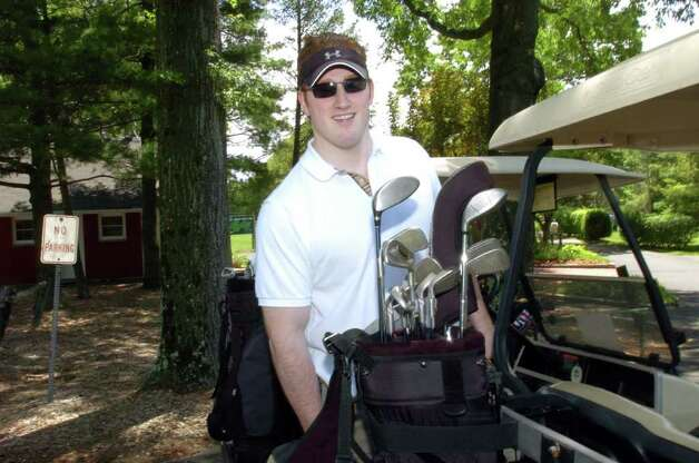 In this June 2006 file photo, Greenwich's Joe Burton, who played football at Greenwich High School and Syracuse University, gets ready to begin a golf competition at the Griff golf course, to benefit the GHS football team. Photo: File Photo / Greenwich Time File Photo