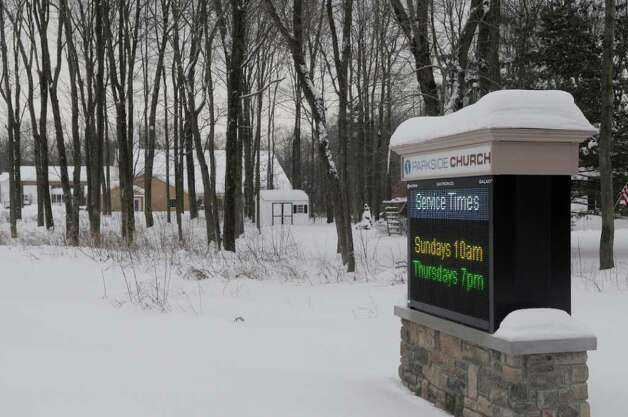 A view of the electronic message board for Parkside Church in Clifton Park.  The church is locatd through the trees in the background of the photograph. The church's pastor says he's tried to keep the brightness of the sign so that it doesn't turn residents off.  (Paul Buckowski / Times Union) Photo: Paul Buckowski / 00011859A