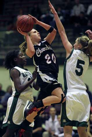 Churchill's Leslie Vorphal drives in for a shot as the Reagan girls play Churchill at Littleton Gymnasium on Tuesday, Jan. 25, 2011. Reagan won 53-44. Photo: TOM REEL, SAN ANTONIO EXPRESS-NEWS / © 2010 San Antonio Express-News