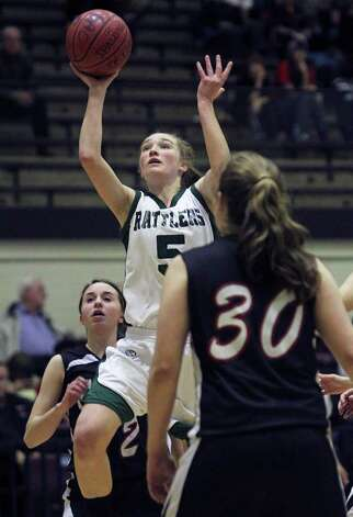 Rattlers guard Wendy Knight takes a shot as the Reagan girls play Churchill at Littleton Gymnasium on Tuesday, Jan. 25, 2011. Reagan won 53-44. Photo: TOM REEL, SAN ANTONIO EXPRESS-NEWS / © 2010 San Antonio Express-News