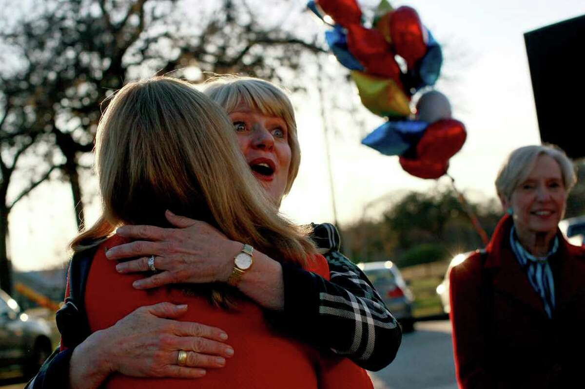 Elizabeth Ames Jones, center, embraces Elizabeth Cunningham, a friend from junior high and high school, while Sally Dooley, right, looks on as Jones greets supporters at the event to formally announce her run for U.S. Senate at her campaign headquarters in San Antonio on Tuesday, January 25, 2011.