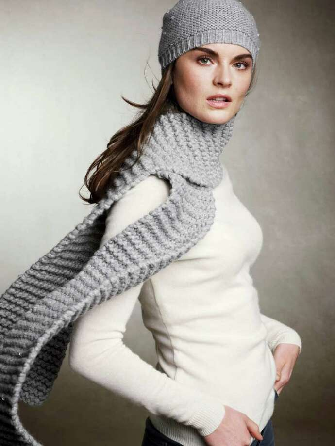 This product image courtesy of Talbots shows their Crystal sprinkled scarf. A scarf can be a wardrobe's workhorse. It adds color, it adds style, and, especially as the weather turns increasingly wintery, it gives warmth. (AP Photo/Talbots) NO SALES Photo: HO / Talbots