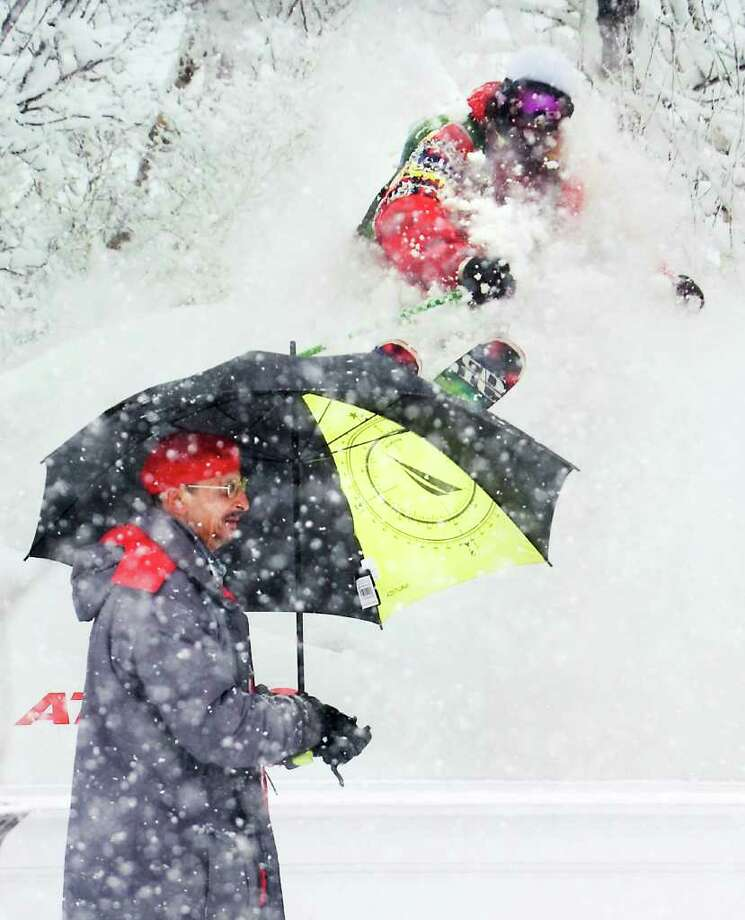 A man walks by the window at Pedigree Ski Shop as another winter storm hits the area in Stamford, Conn. on Wednesday January 26, 2011. Photo: Kathleen O'Rourke / Stamford Advocate