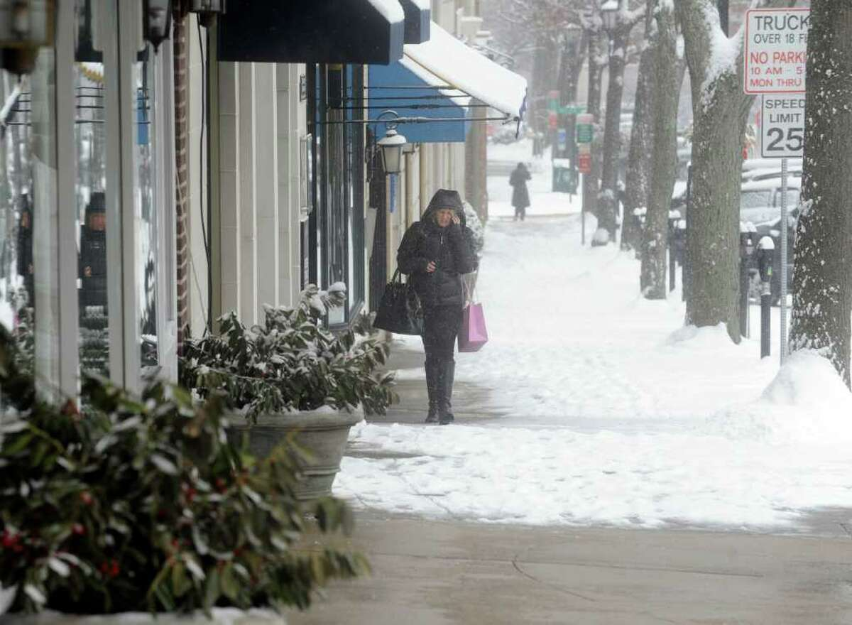 Killeen Faughnan, of Greenwich, shopping on Greenwich Avenue, in the snow in Greenwich on Wednesday, Jan. 26, 2011.