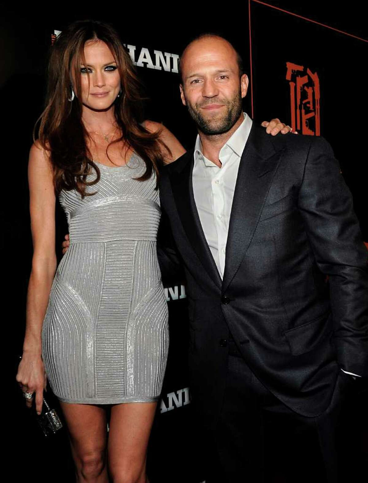 Actor Jason Statham, right, and actress Mini Anden arrives at the premiere of the feature film