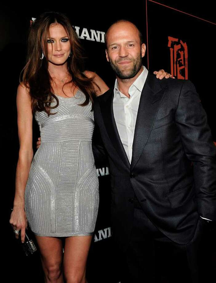 "Actor Jason Statham, right, and actress Mini Anden arrives at the premiere of the feature film ""The Mechanic"" in Los Angeles on Tuesday, Jan. 25, 2011. Photo: AP"