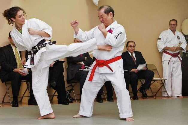 p>sensi alessandra swart (left) delivers a side kick 544457 - san