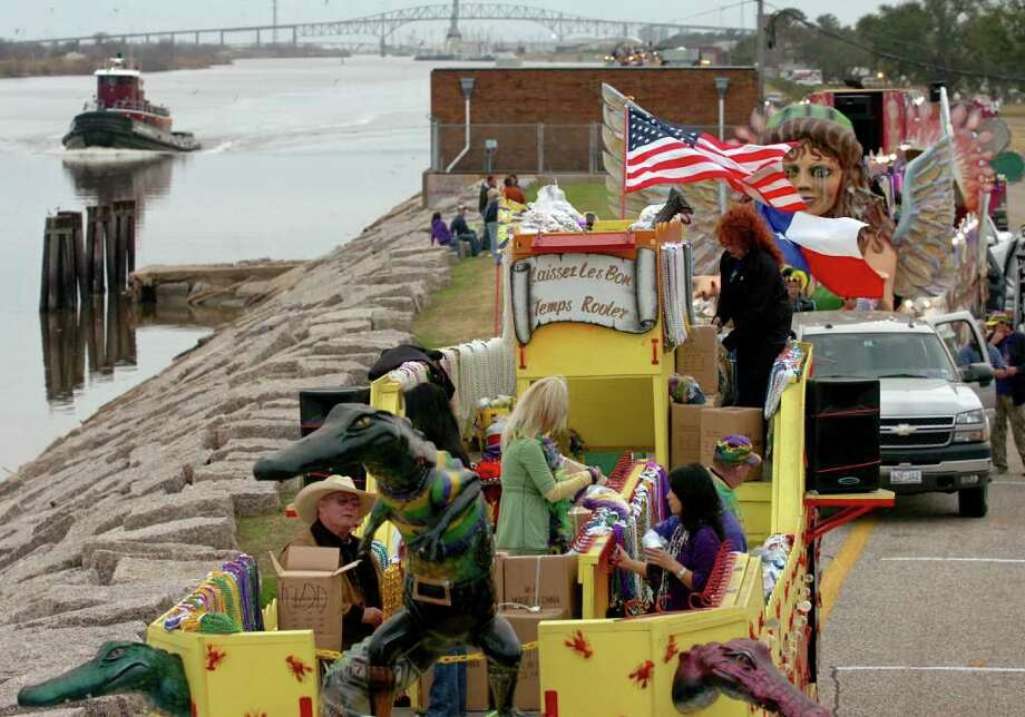 The tug boat Mary Moran (left) cruises down the Sabine Neches Intracoastal Waterway as parade floats are prepared before the annual Southeast Texas Mardi Gras in Port Arthur on Saturday, Feb. 2, 2008.  Mark M. Hancock / The Beaumont Enterprise Photo: Mark M. Hancock