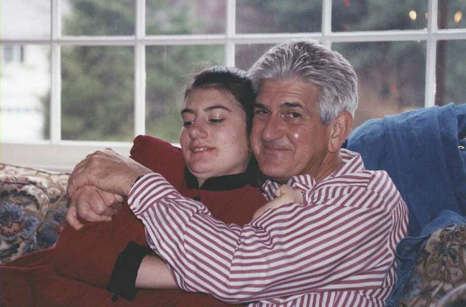 Les and Lauren share a hug. Photo: Contributed Photo;Paresh Jha Staff Photo, Contributed Photo / New Canaan News