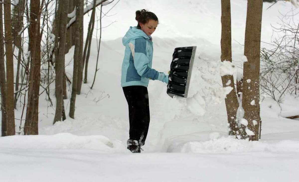 Sixteen-year-old Rachel Doran shovels the walkway near her home in Milford, Conn. Wednesday, Jan. 26, 2011.
