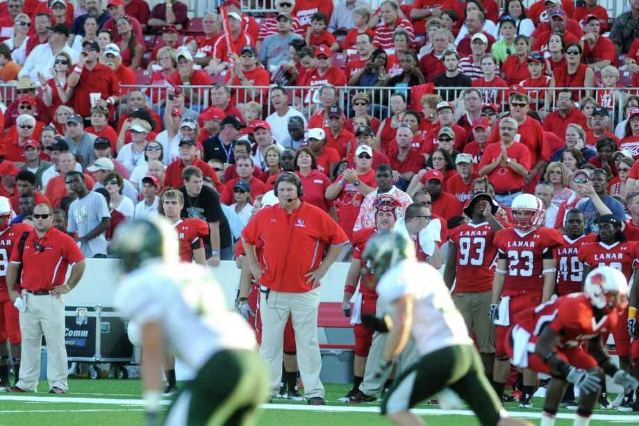 Cardinals head coach Ray Woodard watches his team in the first half against Webber International at Provost Umphrey Stadium on September 11. Woodard thinks it's important for Lamar to get competitive quickly and to keep attendance up. Valentino Mauricio/The Enterprise Photo: Valentino Mauricio / Beaumont