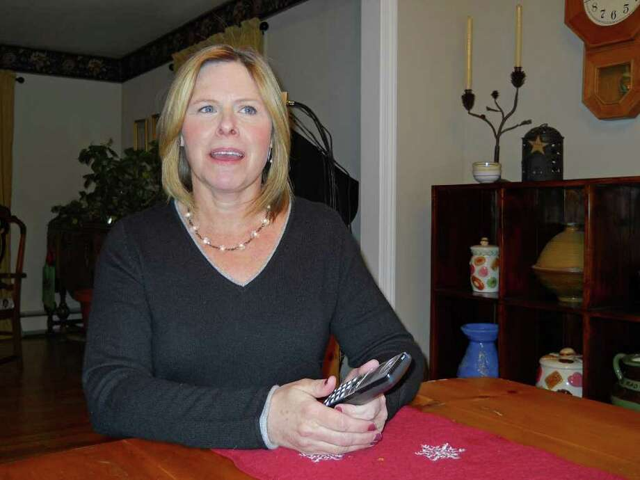 Lisa Reeves sits in her home and talks about being called by a likely scammer who said she owed money and threatened legal action unless she paid up in Valatie, N.Y. on January 26, 2011.  (Cathy Woodruff / Times Union) Photo: Cathy Woodruff