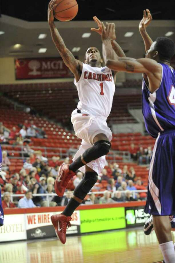 Lamar guard Anthony Miles tries for a layup against Northwestern State defender William Mosley, right at the Montagne Center on Wednesday, January 26, 2011.  Valentino Mauricio/The Enterprise Photo: Valentino Mauricio / Beaumont