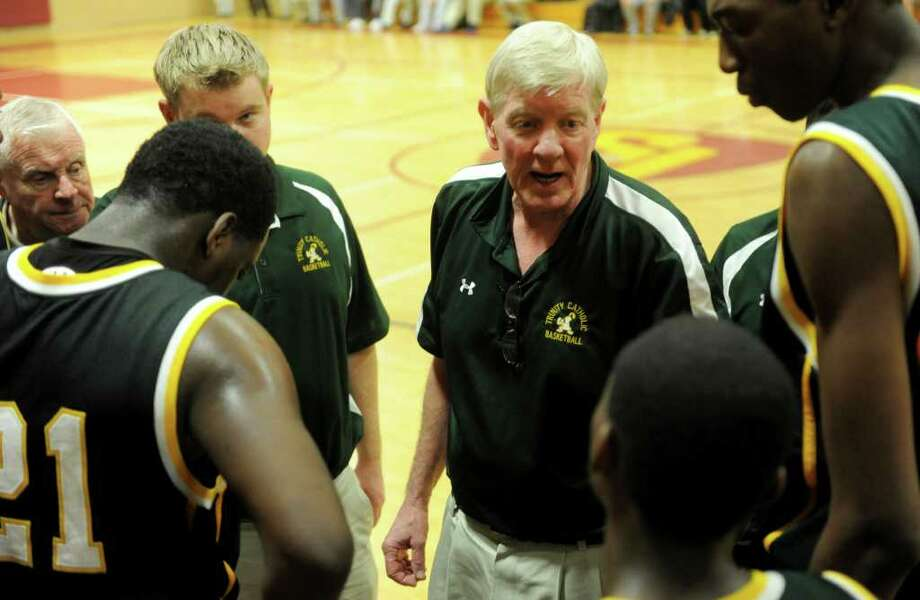 Trinity Catholic's coach Mike Walsh talks to his team in between quarters during Tuesday's game between Trinity and St. Joseph in Trumbull on December 21, 2010. Photo: Lindsay Niegelberg, ST / Connecticut Post