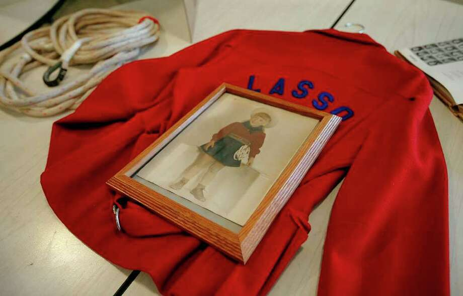 An example of the uniform worn by previous generations is displayed at the Lasso Alumni recognition ceremony at Thomas Jefferson High School on Wednesday, Jan. 26, 2011. Photo: KIN MAN HUI, SAN ANTONIO EXPRESS-NEWS / San Antonio Express-News