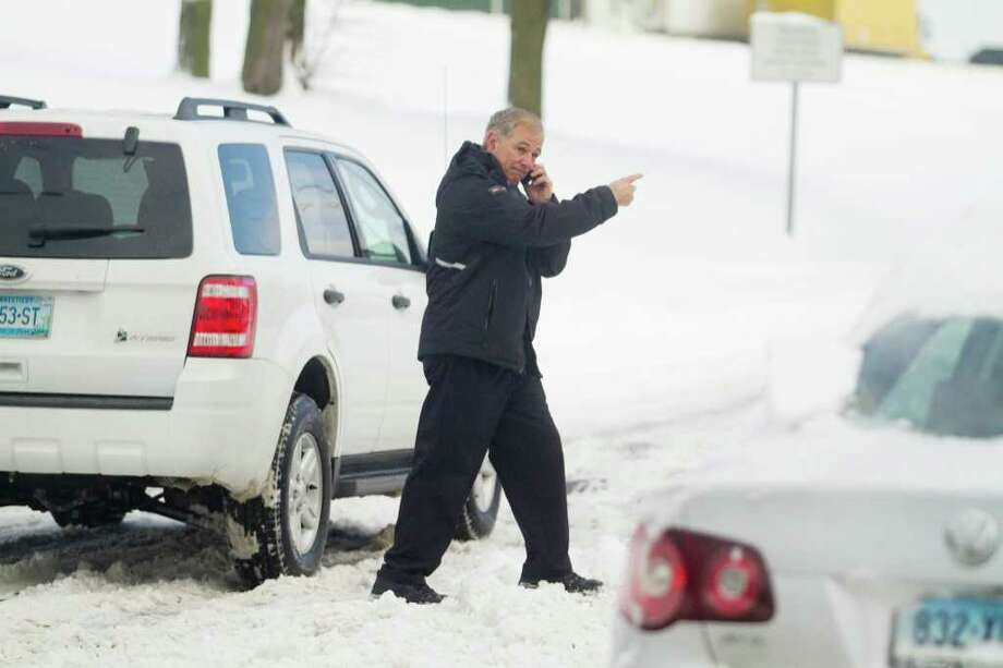 Bobby Valentine, the City of Stamford's Public Safety Director, indicates to a driver that I-95 is closed after a snow storm in Stamford, Conn. on Thursday, Jan. 27, 2011 Photo: Chris Preovolos / Connecticut Post