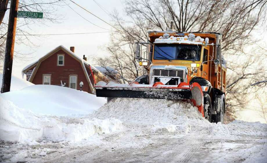 A Danbury city plow truck clears the streets on Homestead and Holley after the overnight ssnowfall, Thursday, January 27, 2011. Photo: Carol Kaliff / The News-Times