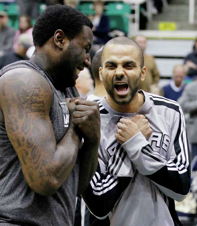 Spurs forward DeJuan Blair, left, and guard Tony Parker of France, right, joke before an NBA basketball game against the Jazz in Salt Lake City, Wednesday Jan. 26, 2011. Photo: AP