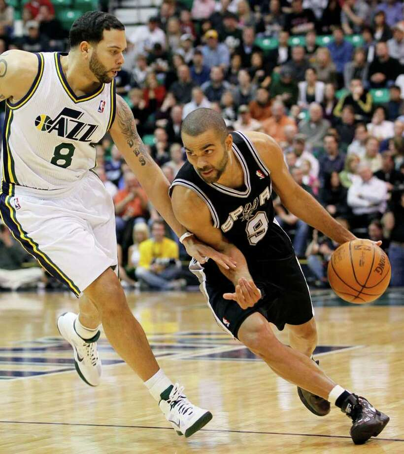 Spurs guard Tony Parker of France (9) attempts to get around Jazz guard Deron Williams (8) during the first half of an NBA basketball game in Salt Lake City, Wednesday Jan. 26, 2011. Photo: AP