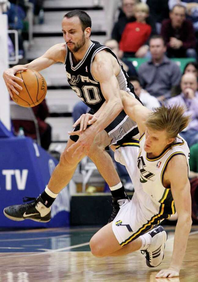 Spurs shooting guard Manu Ginobili of Argentina, left, collides with Jazz forward Andrei Kirilenko, right, during the second half of an NBA basketball game in Salt Lake City, Wednesday Jan. 26, 2011. Kirilenko was charged with a foul on the play. Ginobili scored 26 points in The Spurs 112-105 win. Photo: AP