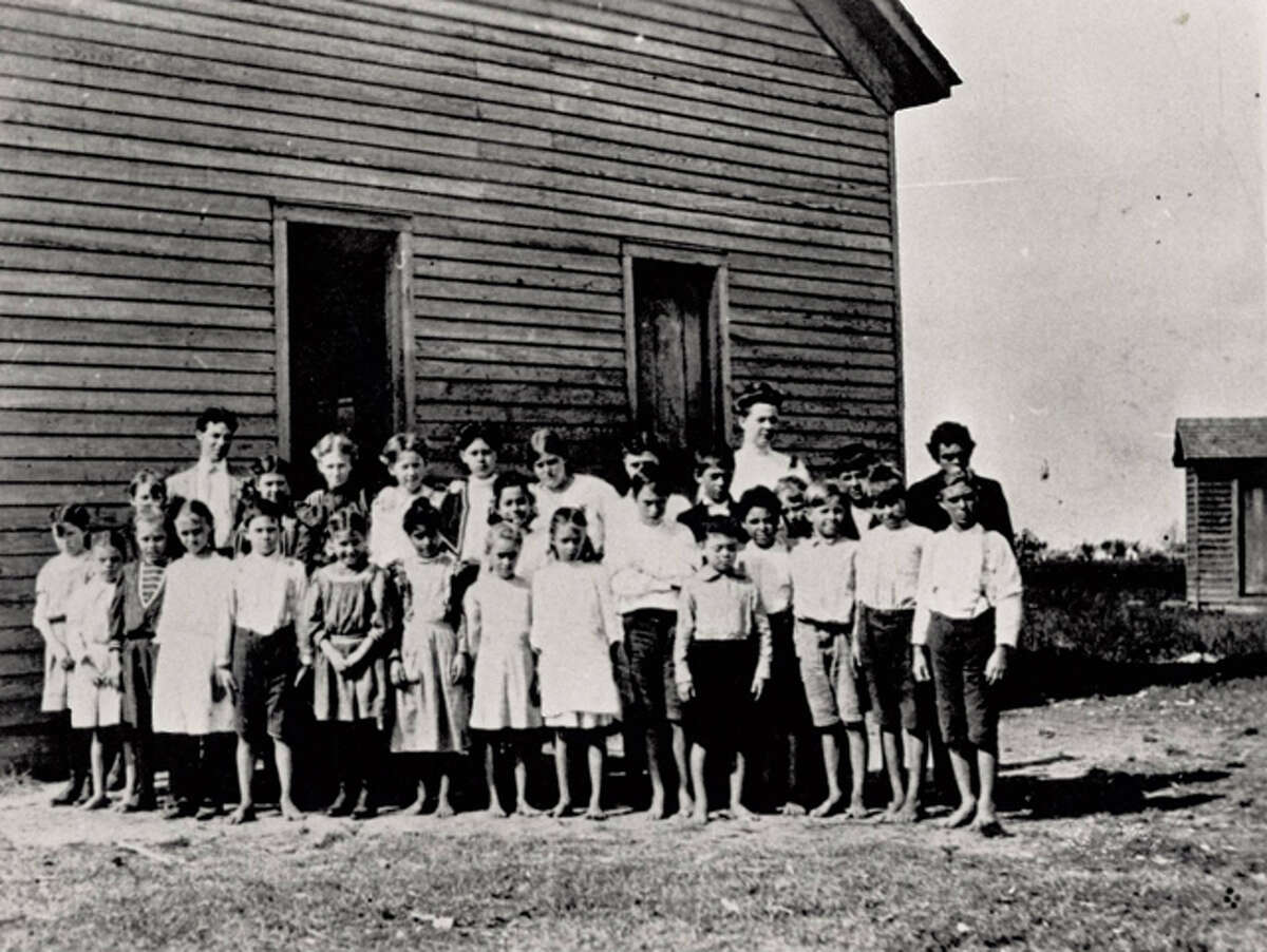 Photo taken between 1907-190 of original South Park School. Note: students have no shoes on.